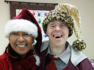 Ches Wallace and friend in Christmas hats!
