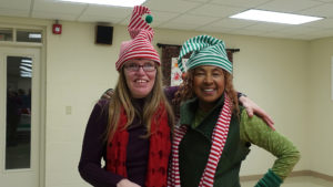 Jessica and Sonya smile and pose for the camera at the Arc's Annual Christmas Cookie Party