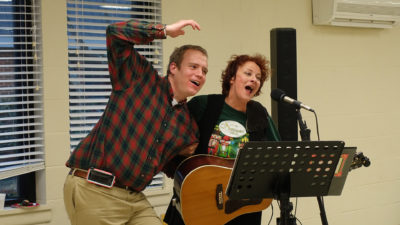 Robert Metz and Leslie entertain the room with song during an Arc Community Celebration