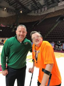 George and coach in the gym at Special Olympics, Roanoke VA