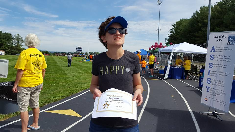 Becky holds her certificate of completion at EFFORT Day